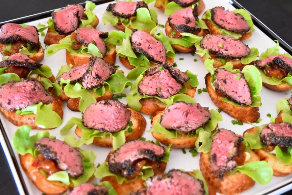 Peppered beef medallions with bush tomato relish on charred sour dough